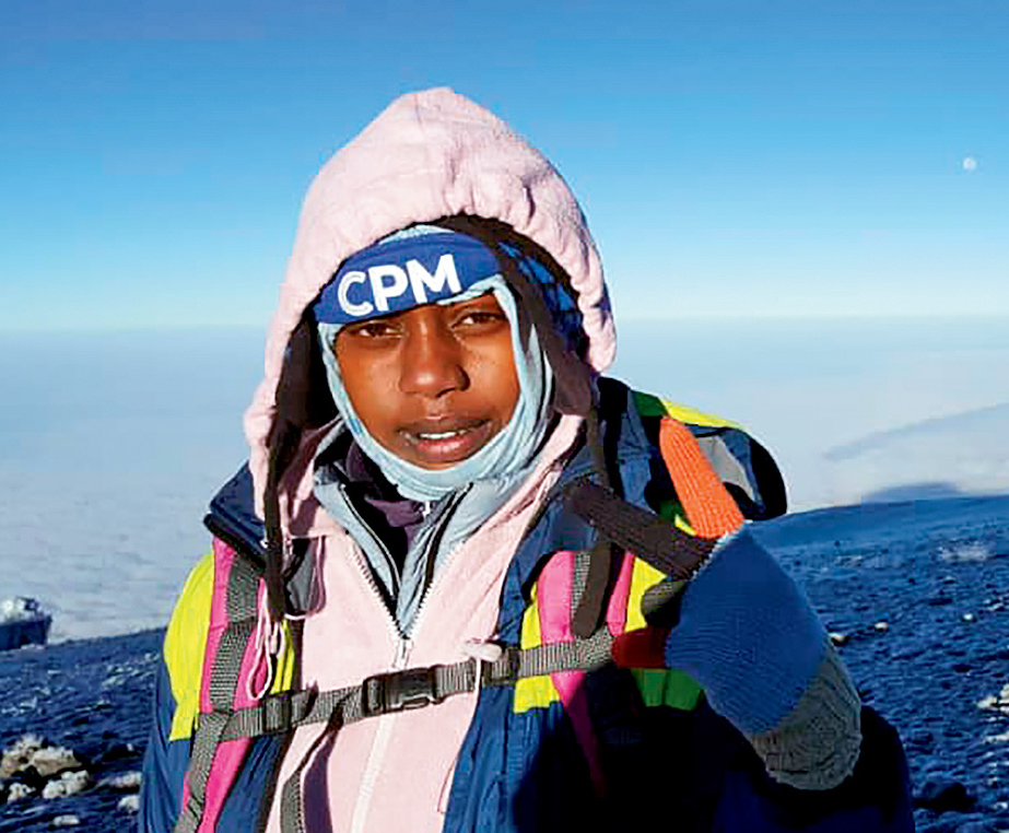 Asifiwe Makere at sunrise near the summit of Kilimanjaro. Glory Thobias Salema launched the TWGF in 2015, she says, to empower women to become guides. [Photo] Asifiwe Makere
