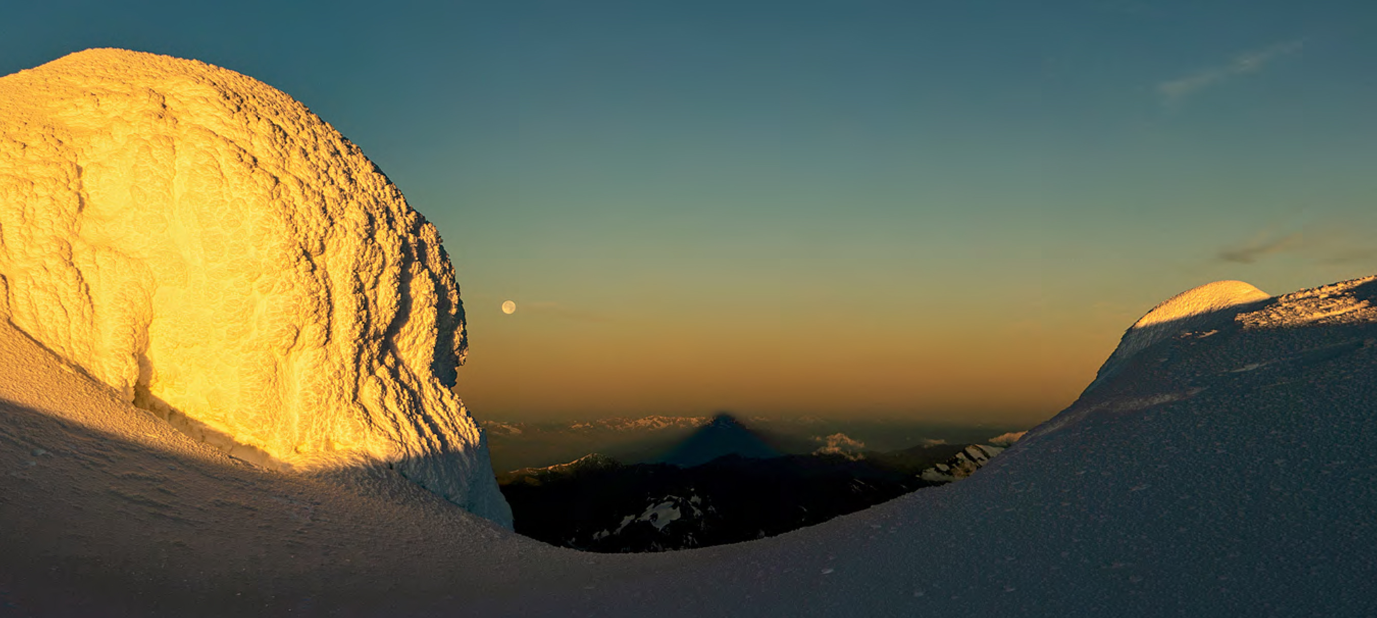 Looking west to the mountain's shadow cast by the rising sun behind. [Photo] Uisdean Hawthorn