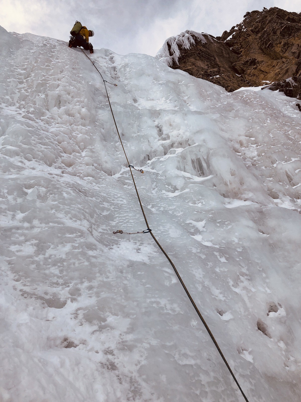 Cold, wet conditions with dry snow on the belay ledges made for tricky conditions—but Bruno Schull makes it look easy above Sertig, Switzerland. [Photo] Rob Coppolillo
