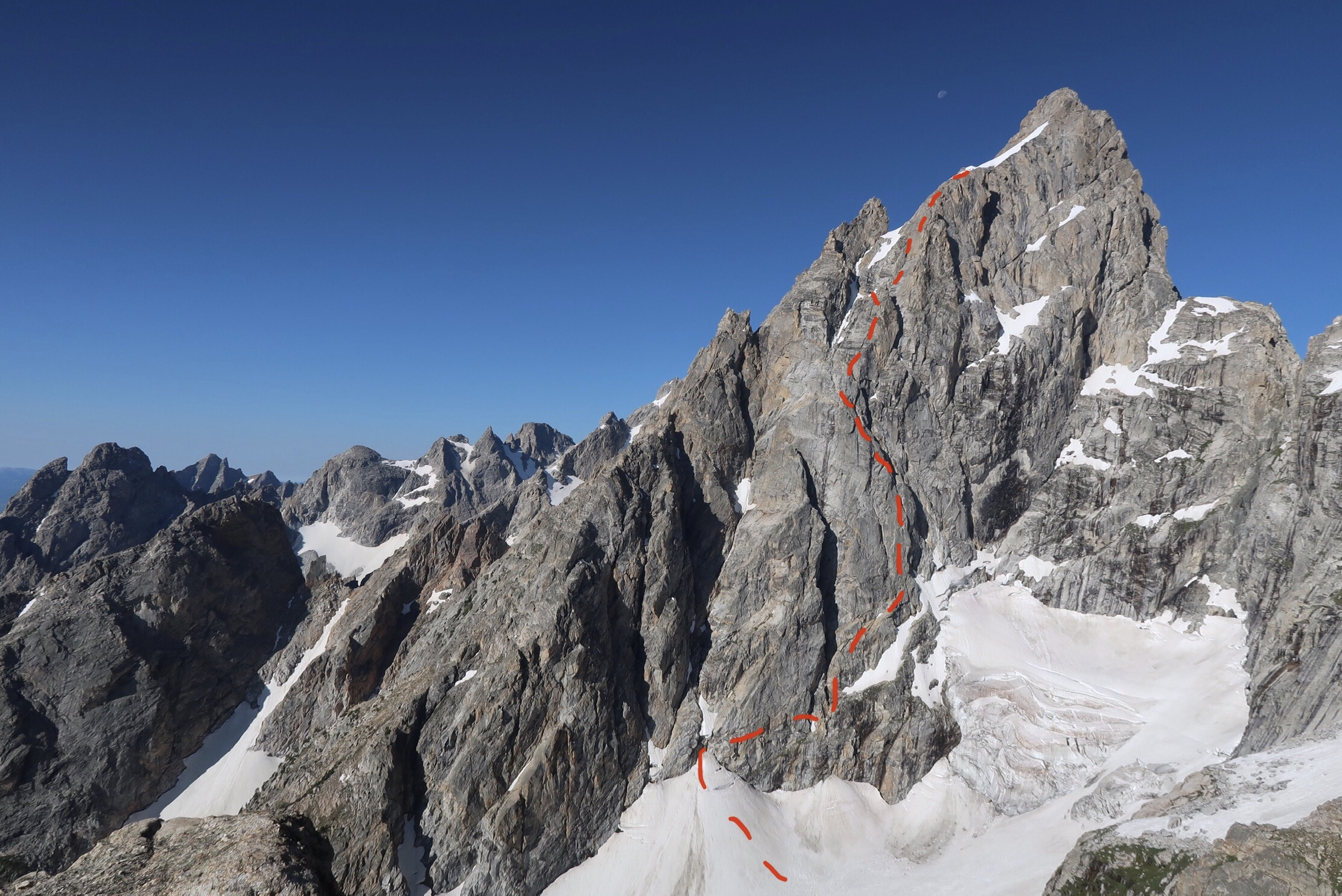 The north face of the Grand Teton with the approximate route of the North Buttress Direct drawn in red. The photo was taken from somewhere between Teewinot and Mt. Owen while on the Grand Traverse route a week earlier. [Image] Justin Bowen