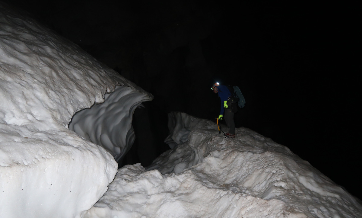 Mark Jenkins staring into the bergschrund below the start of route at 4:45a.m. [Photo] Justin Bowen