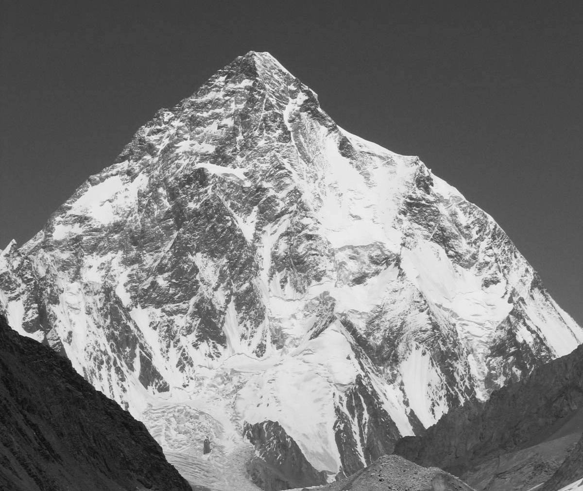 K2 (8611m) is pictured here in summer. The Abruzzi Spur—the route used by all the expeditions this winter—follows the right-hand skyline. [Photo] Svy123, Wikimedia Commons