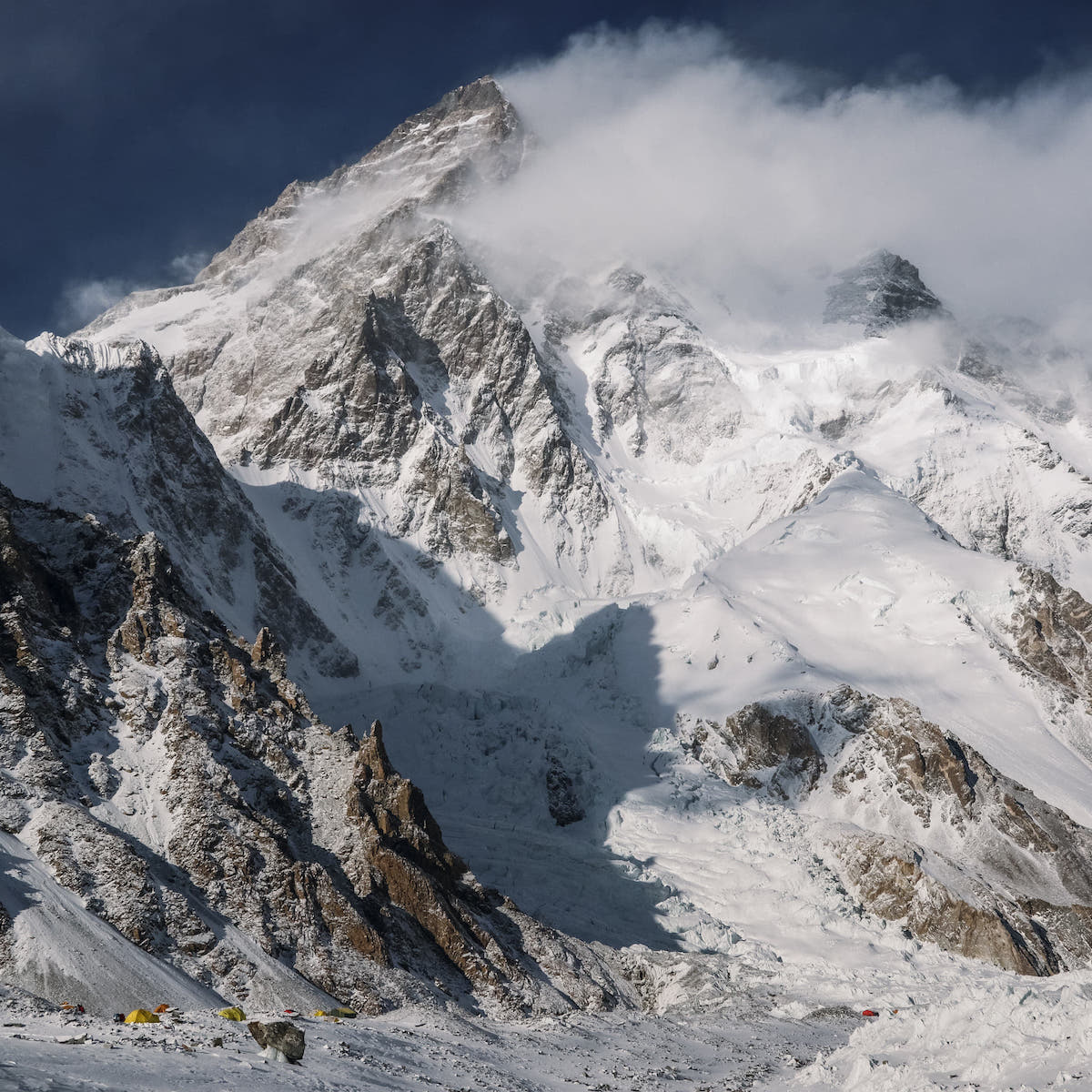 K2 (8611m) looms above base camp on the Godwin Austen Glacier. [Photo] Alex Gavan