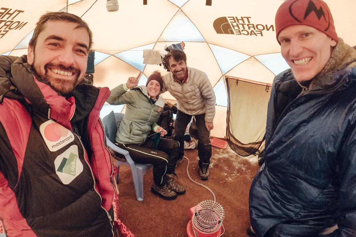 A strategy meeting in the base camp dining tent with friends Muhammad Ali Sadpara (center right) and John Snorri Sigurjonsson (right). [Photo] Alex Gavan