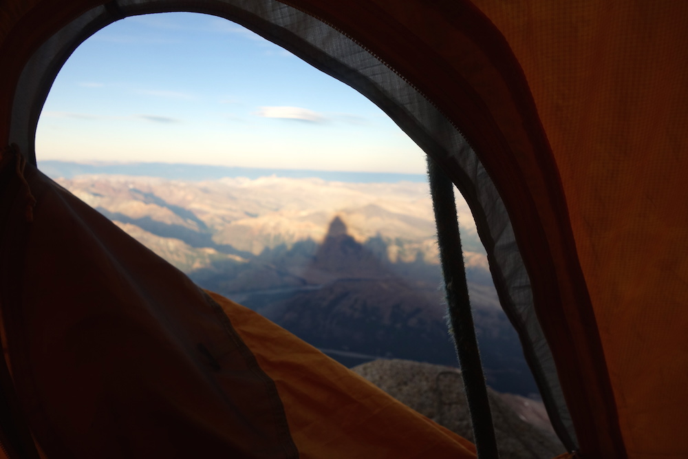 A view from the tent during the traverse, with the looming shadow of the Fitz Roy massif visible. [Photo] Sean Villanueva O'Driscoll